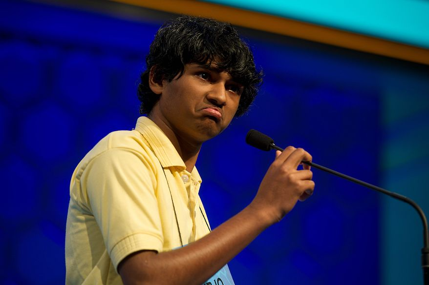 "Barbara L. Salisbury/The Washington Times Surjo Bandyopadhyay, 14, of Lusby, Md., grimaces when given the word ""nachschlag"" to spell in the semifinals of the 2011 Scripps National Spelling Bee on Thursday. He misspelled what he jokingly called a ""strange word."""