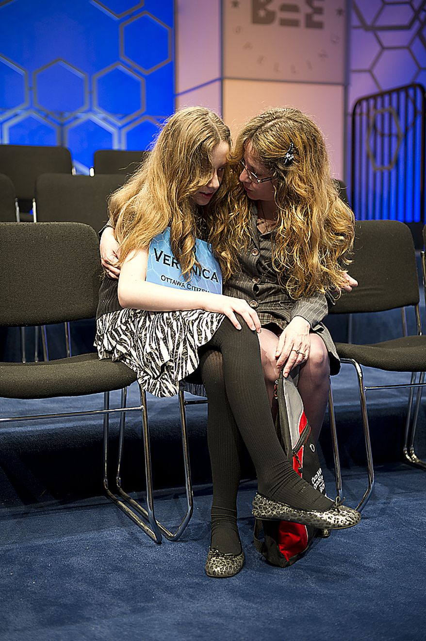 Veronica Penny, 13, of Rockland, Ottawa, Canada, has a quiet moment with her mom on stage after making it to the final round of the 2011 Scripps National Spelling Bee on Thursday, June 2, 2011 at the Gaylord National in Oxon Hill, Md. Veronica is one of 13 spellers who will compete live tonight on ESPN for the $30,000 prize. (Barbara L. Salisbury/The Washington Times)