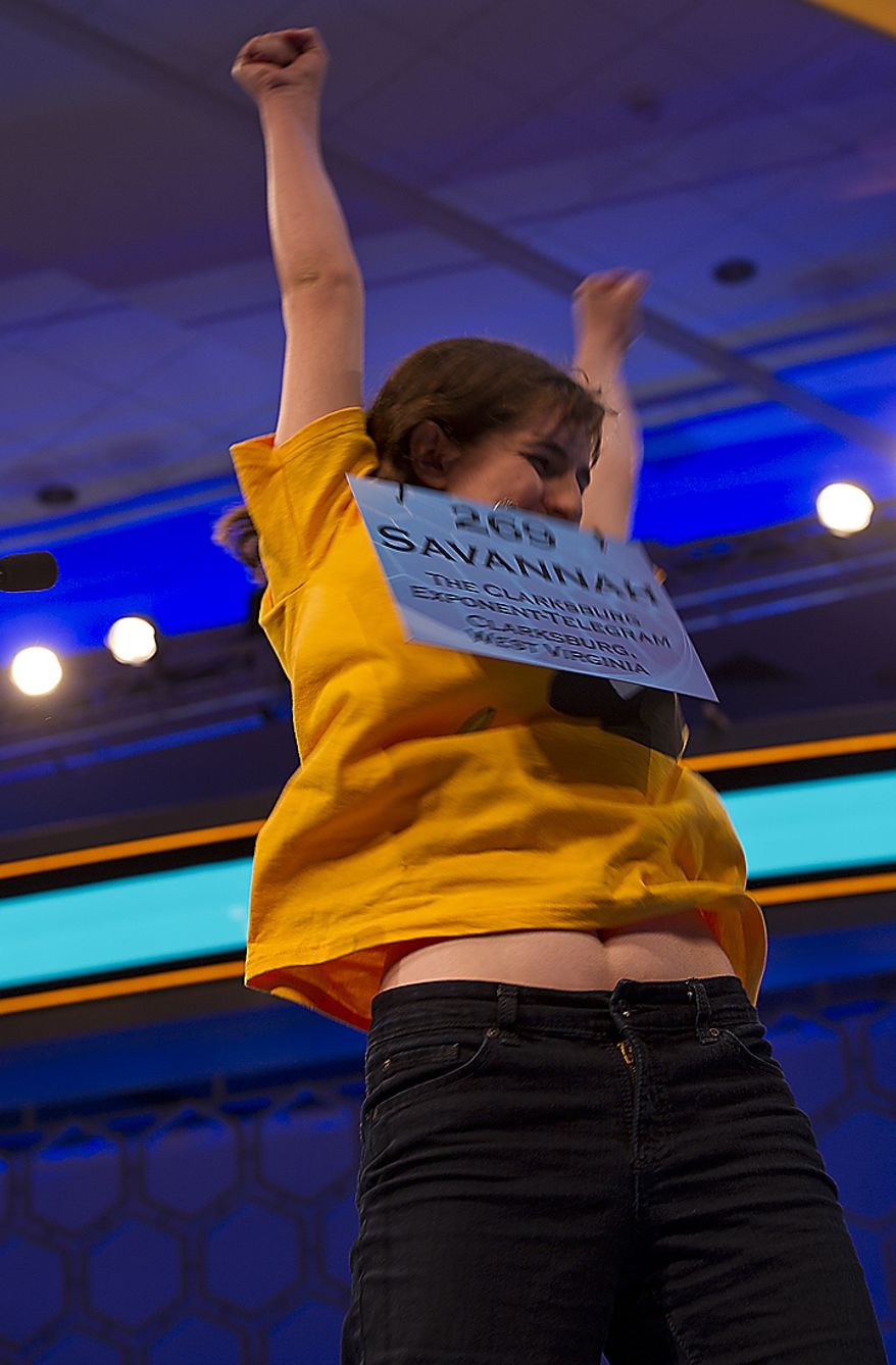 "Savannah Aldridge, 13, of Clarksburg, W.Va., throws up her arms after correctly spelling ""soliloquy"" during Round Two of the 2011 Scripps Howard National Spelling Bee on Wednesday, June 1, 2011. Two hundred and seventy-five spellers from around the country competed in rounds two and three of the bee Wednesday at the Gaylord National in Oxon Hill, Md. Spellers were not eliminated during Wednesday's rounds, but rather earned points towards competing in the semifinals, which will be held Thursday. (Barbara L. Salisbury/The Washington Times)"