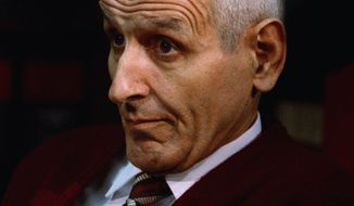 ** FILE ** In this Dec. 3, 1990, file photo, Dr. Jack Kevorkian sits in his lawyer's office in Southfield, Mich., after Oakland County Prosecutor Richard Thompson announced that he would be charged with murder in the death of a woman who committed suicide by using a device of the doctor's. (AP Photo, File)