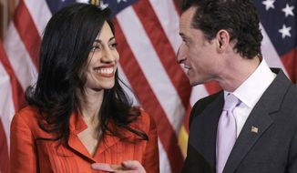 ** FILE ** Rep. Anthony Weiner, New York Democrat, and his wife, Huma Abedin, who is an aide to Secretary of State Hillary Rodham Clinton, are pictured after the ceremonial swearing in of the 112th Congress on Capitol Hill in Washington on Jan. 5, 2011. (AP Photo/Charles Dharapak)
