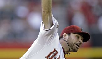 Arizona Diamondbacks rookie starter Josh Collmenter was one of three Arizona pitchers to shutdown the Washington Nationals Saturday night in the 4-0 Diamondbacks win. Collmenter tossed seven innings, allowing three hits and striking out five. (AP Photo/Paul Connors)