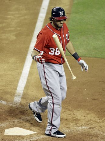 Washington Nationals' Michael Morse reacts after striking out against the Arizona Diamondbacks in the eighth inning of an MLB baseball game on Saturday, June 4, 2011, in Phoenix. The Diamondbacks won 2-0. (AP Photo/Paul Connors)
