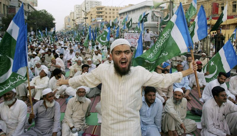 A supporter of the Pakistani religious party Jamaat-e-Islami shouts during a rally against drone attacks Saturday, June 4, 2011, in Karachi, Pakistan. Ilyas Kashmiri, a top al Qaeda commander and possible replacement for Osama bin Laden who is accused of the 2008 Mumbai massacre, was killed in an American drone-fired missile strike close to the Afghan border, a fax from the militant group he heads and a Pakistani intelligence official said Saturday. (AP Photo/Fareed Khan)