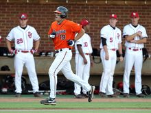 Virginia's Steven Proscia (19) runs to home plate after hitting a two-run home run against St. John's during the NCAA college regional baseball tournament on Saturday, June 4, 2011, in Charlottesville, Va. Virginia won 10-2. (AP Photo/Andrew Shurtleff)