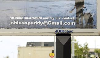 ASSOCIATED PRESS Feilim Mac An Iomaire stands next to a billboard he created in Dublin to advertise his desperation for a job. Tens of thousands of Irish people are leaving their debt-battered land because they can't find work. The $2,800 ploy apparently is a success.