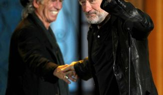 ASSOCIATED PRESS Keith Richards (left) and Robert De Niro share the stage at Spike TV's annual Guys Choice Awards. Mr. Richards claimed the night's final honor, a lifetime achievement trophy called the Brass Balls award.
