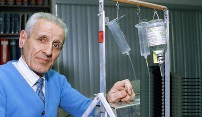 """Jack Kevorkian is seen here in February 1991 showing off his homemade suicide machine, with which he assisted in the suicides of about 130 people. """"Doctor Death,"""" as he came to be known, died Friday at age 83 at a Detroit-area hospital. (Associated Press)"""