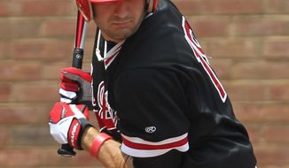 ASSOCIATED PRESS St. John's Jeremy Baltz is hit with a pitch Sunday during game five of the NCAA regional baseball tournament  vs. East Carolina in Charlottesville, Va.