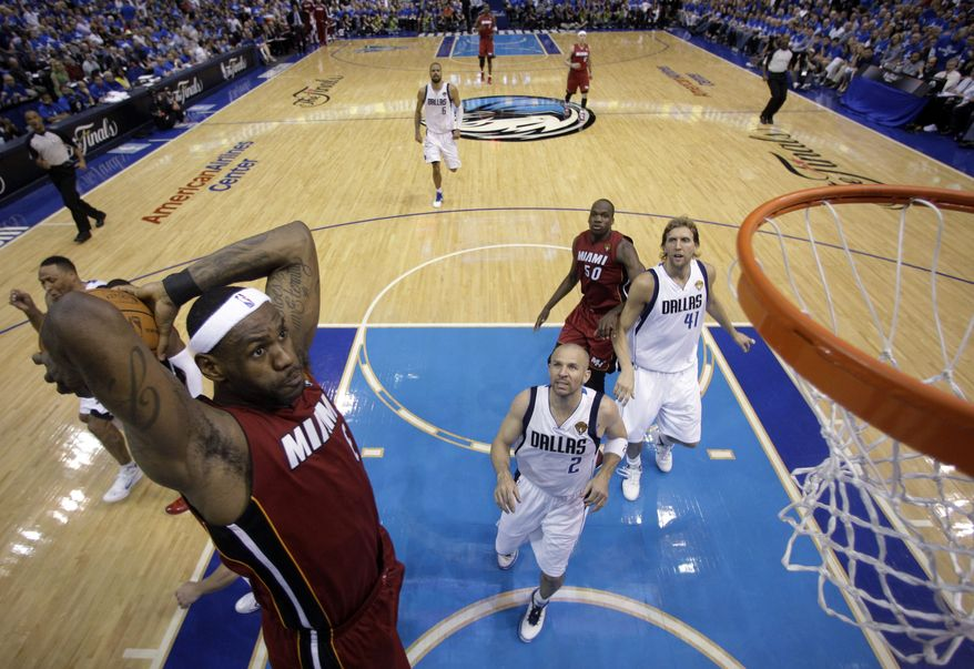 Miami Heat's LeBron James dunks during the second half of Game 3 of the NBA Finals basketball game against the Dallas Mavericks Sunday, June 5, 2011, in Dallas. (AP Photo/David J. Phillip; Pool)