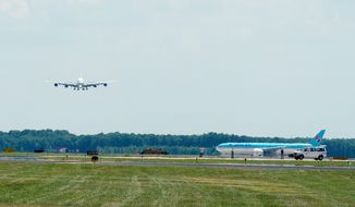 ** FILE ** The first Air France Airbus A380 flight prepares for landing at Washington Dulles International Airport in Virginia in this file photo from June 2011. The double-decker plane is 238 feet long, 79 feet tall and has a wing span of 261 feet. (Barbara L. Salisbury/The Washington Times)
