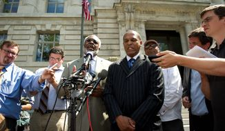 Flanked by his attorney, Frederick D. Cooke Jr., D.C. Council member Harry Thomas Jr. (right) refuted the city attorney general's allegations regarding the use of grant money and charitable donations at an afternoon news conference. (Rod Lamkey Jr./The Washington Times)