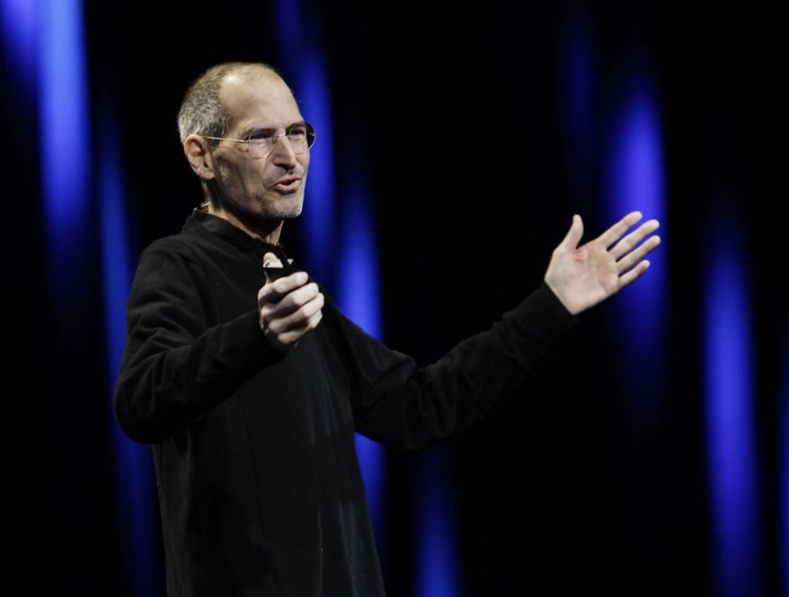 Apple CEO Steve Jobs gestures to his audience during a keynote address to the Apple Worldwide Developers Conference in San Francisco on June 6, 2011. (Associated Press)
