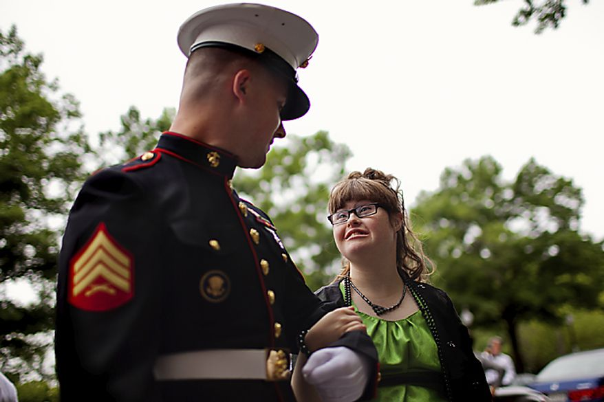 Nikki Reese, right, a senior at Woodbridge High School, is escorted by Marine Sgt. Jacob DeMille to the 6th annual Cinderella Ball, at the Willard InterContinental Hotel, in Washington, D.C., Sunday, June 5, 2011. The ball, put on by The House, Inc., is for local students with life-threatening illnesses or disabilities. The House, Inc. is a leadership resource for area students that offers before and after school  programs and weekend activities. (Drew Angerer/The Washington Times)