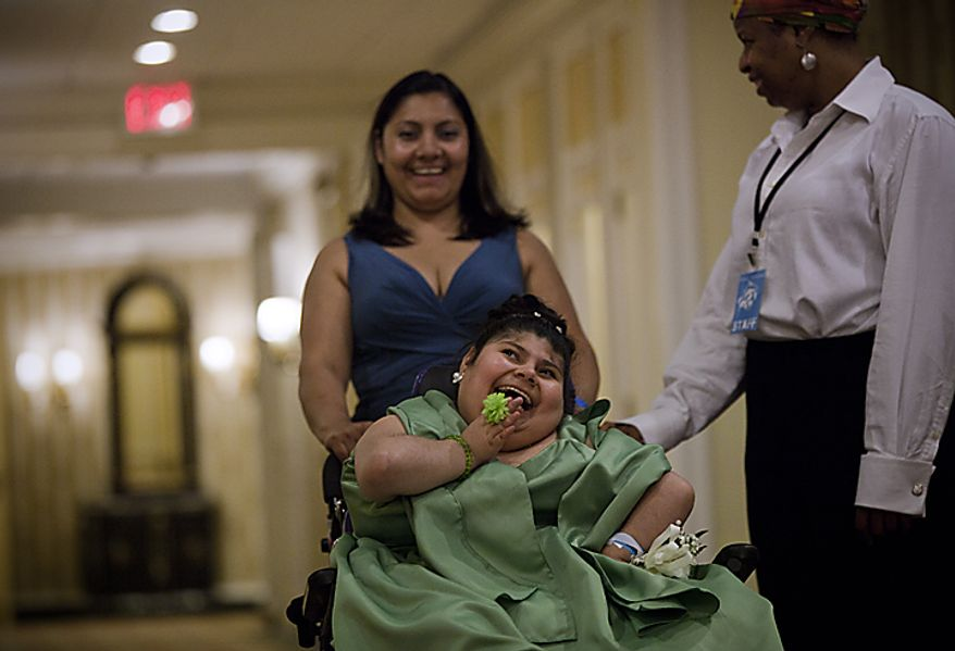 A student shares a laugh with her mother and a staff member at the Cinderella Ball at The Willard Intercontinental Hotel in Washington, D.C. on Sunday, June 5, 2011. This was the sixth annual Cinderella Ball, where students with life-threatening illnesses or disabilities came together to celebrate. (Pratik Shah/The Washington Times)
