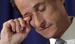 """U.S. Congressman Anthony Weiner, D-NY, wipes his eye during a news conference in New York, Monday, June 6, 2011. After days of denials, a choked-up New York Democratic Rep. Anthony Weiner confessed Monday that he tweeted a bulging-underpants photo of himself to a young woman and admitted to """"inappropriate"""" exchanges with six women before and after getting married. (AP Photo/Richard Drew)"""