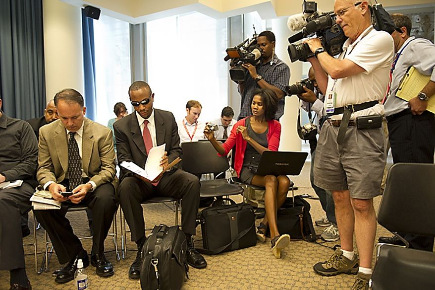 Sulaimon Brown waits on June 6, 2011, to testify before a D.C. Council committee at the Wilson Building in Washington about allegations that he was paid off by Mayor Vincent C. Gray, then promised a government job. (Rod Lamkey Jr./The Washington Times)