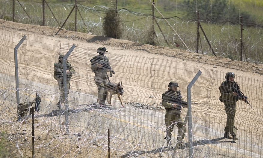 Israeli troops patrol the border between Israel and Syria near the village of Majdal Shams in the Golan Heights early on Monday, June 6, 2011. Israel braced for more border violence after a day of deadly clashes with pro-Palestinian protesters who tried to surge into the Israeli-controlled Golan from Syria. (AP Photo/Ariel Schalit)
