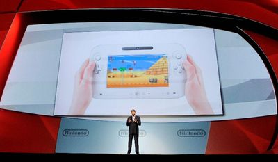 ASSOCIATED PRESS Reggie Fils-Aime, president of Nintendo of America, introduces the Wii U gaming console at the E3 Gaming Convention in Los Angeles on Tuesday. Its controller contains a 6.2-inch touch screen so gamers can play while others watch TV.