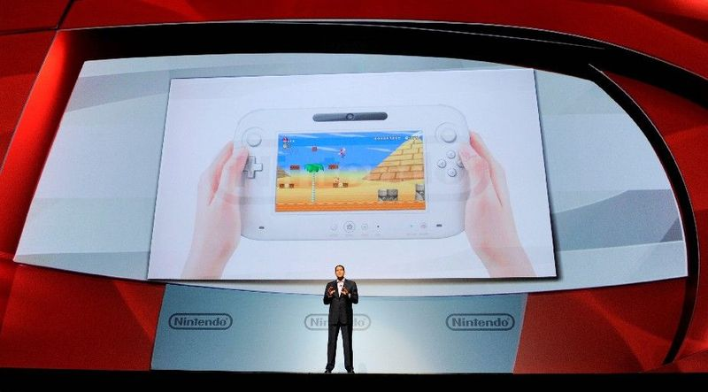 ASSOCIATED PRESS Reggie Fils-Aime, president of Nintendo of America, introduces the Wii U gaming console at the E3 Gaming Convention in Los Angeles on Tuesday. Its controller contains a 6.2-inch touch sc