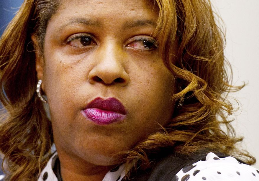 ROD LAMKEY JR./THE WASHINGTON TIMES UNDER OATH: Cherita Whiting testifies at an oversight hearing before the Government Operations Committee on Monday.