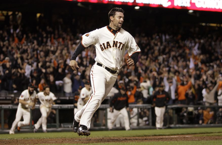 San Francisco Giants' Chris Stewart celebrates after scoring the game winning run against the Washington Nationals during the 13th inning of a baseball game Monday, June 6, 2011, in San Francisco. Stewart scored on a hit by Giants' Freddy Sanchez. (AP Photo/Ben Margot)