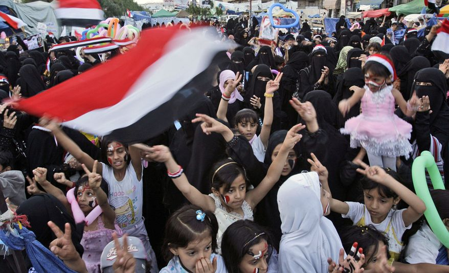 Yemeni children and female anti-government protesters celebrate President Ali Abdullah Saleh's departure to Saudi Arabia, in Sanaa, Yemen, on June 6, 2011. (Associated Press)