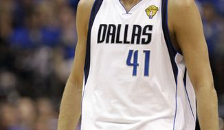 Dallas Mavericks' Dirk Nowitzki had 10 of his 21 points in the fourth quarter against the Miami Heat in the NBA finals to lead the Mavs to a 86-83 win in Game 4. The series is now tied 2-2. (AP Photo/David J. Phillip)