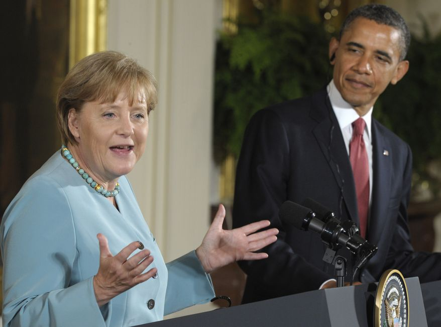 German Chancellor Angela Merkel answers a question during a joint news conference with President Obama in the East Room of the White House in Washington on Tuesday, June 7, 2011. (AP Photo/Susan Walsh)