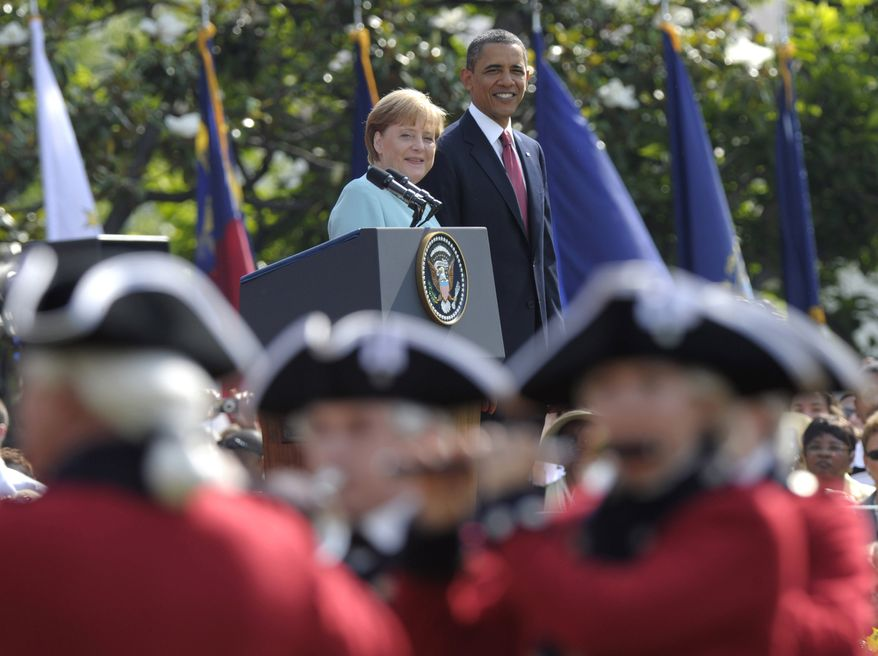 President Obama welcomes German Chancellor Angela Merkel during an arrival ceremony on the South Lawn of the White House in Washington on Tuesday, June 7, 2011. (AP Photo/Susan Walsh)