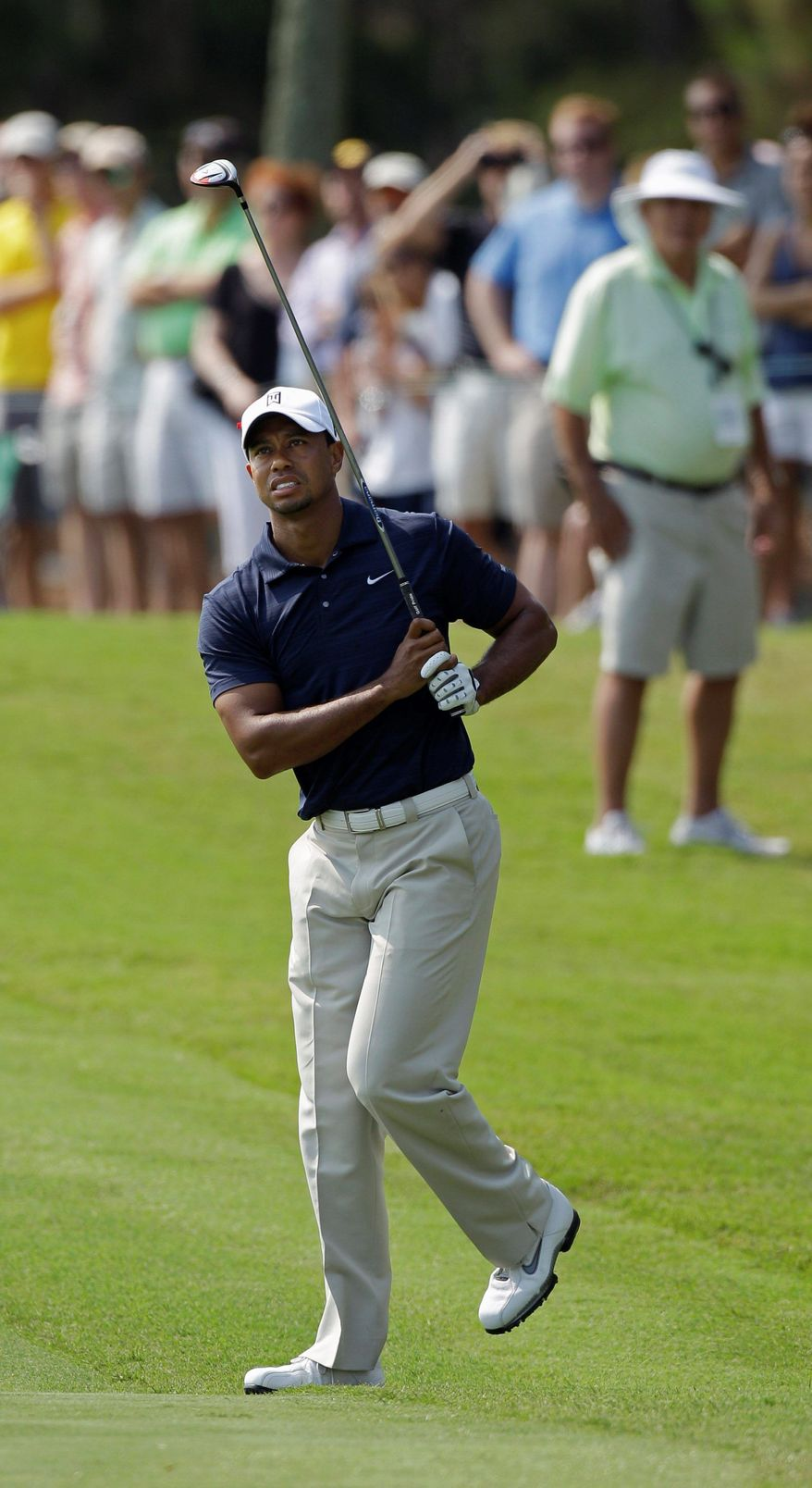 FILE - In this May 12, 2011 file photo, Tiger Woods bends his knee after his second shot on the ninth hole before withdrawing in the first round of The Players Championship golf tournament in Ponte Vedra Beach, Fla. Injuries to his left knee and Achilles' are bad enough that Woods decided Tuesday, June 7, 2011, to skip the U.S. Open for the first time since 1994. The Masters is now the only major he has never missed as a pro. (AP Photo/Chris O'Meara, File)