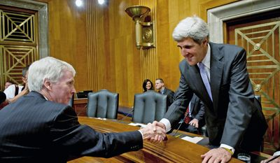 Ryan C. Crocker (left) and Senate Foreign Relations Committee Chairman John Kerry greet each other Wednesday before a two-hour hearing on Mr. Crocker's nomination to be the next U.S. ambassador to Afghanistan. (Associated Press)