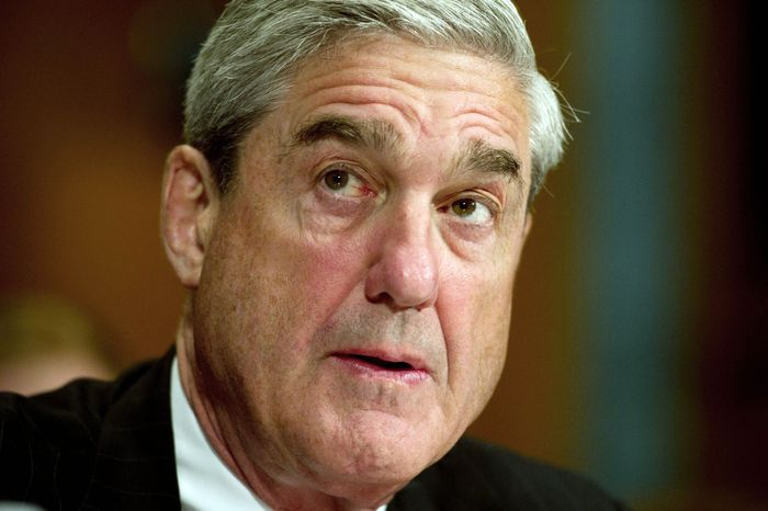 FBI Director Robert Mueller listens to opening statements from lawmakers during a Senate Judiciary Committee hearing Wednesday about extending his 1
