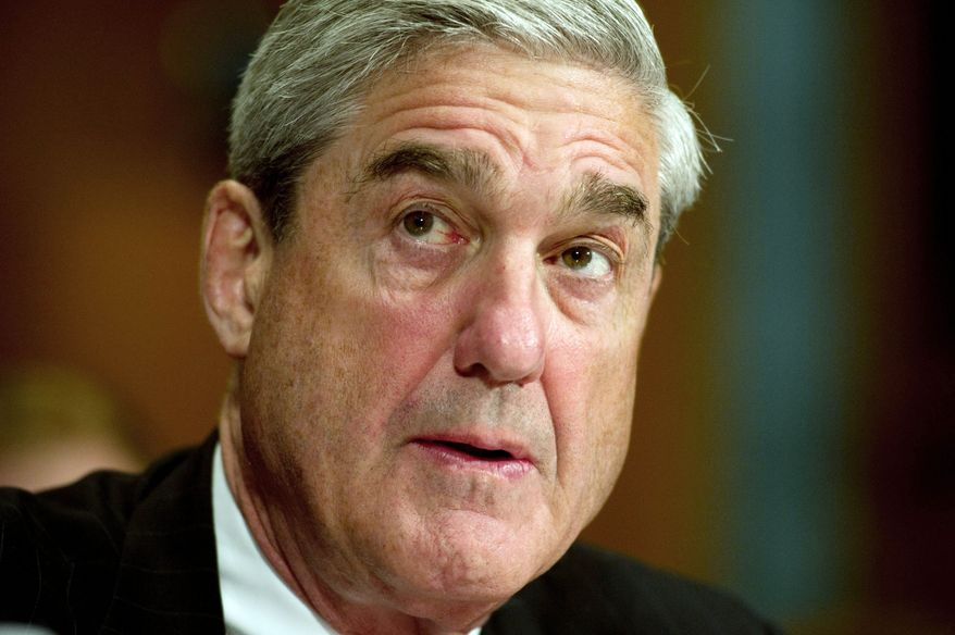 FBI Director Robert Mueller listens to opening statements from lawmakers during a Senate Judiciary Committee hearing Wednesday about extending his 10-year term. (Rod Lamkey Jr./The Washington Times)