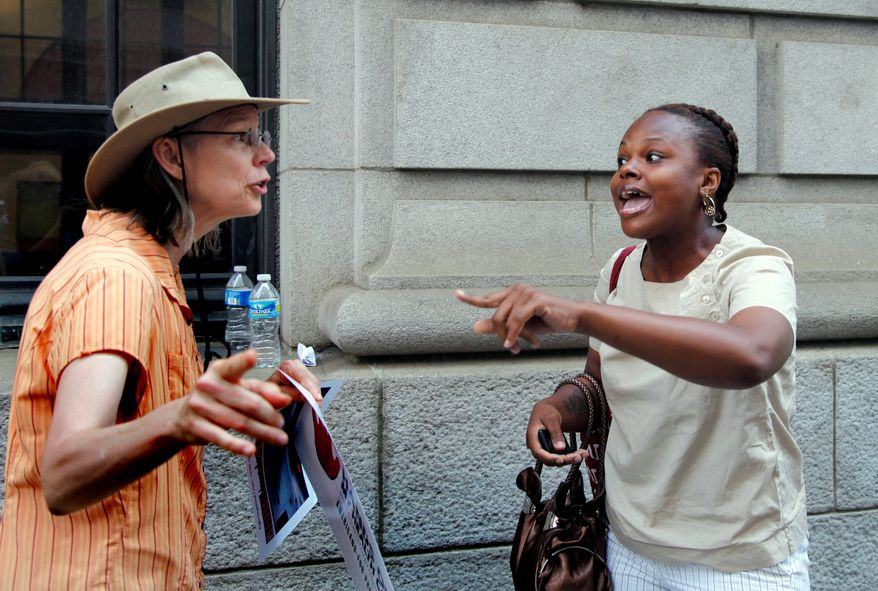 Crystal Johnson (right), a supporter of the health care overhaul, argues with a protester outside the courthouse. Wednesday's nearly 2 1/2-hour hearing is the third time an appeals court has heard a case on the issue.