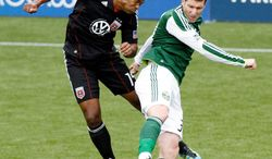 D.C. United rookie defender Ethan White (left) heads the ball against Portland forward Kenny Cooper during United's 3-2 road victory May 29.