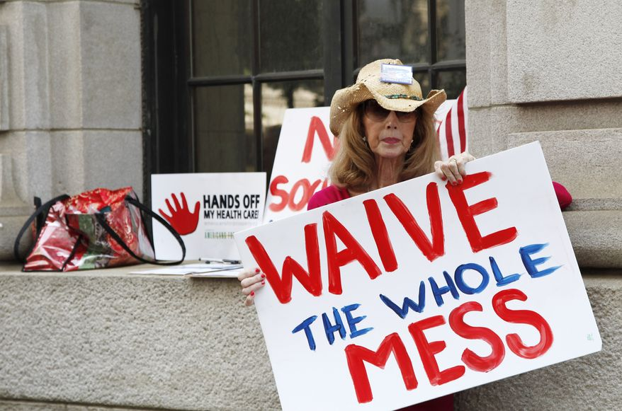 Betsy Burgess of Flowery Branch, Ga., protests President Obama's health care reform plan outside the 11th U.S. Circuit Court of Appeals in Atlanta on June 8, 2011. (Associated Press)
