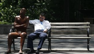 A man takes a nap on a shady park bench next to a sculpture in Dag Hammarskjold Plaza in New York on June 8, 2011. The official start of summer is still two weeks away, but much of the nation is sweating through near-record temperatures. (Associated Press)