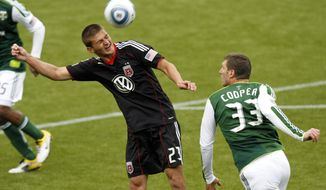 DC United defender Perry Kitchen, left, heads the ball over Portland Timbers forward Kenny Cooper during the first half of their MLS soccer game at the end of May. Most recently, Kitchen and United tied the first-place L.A. Galaxy 0-0 and Kitchen was integral to the solid defensive showing. (AP Photo/Don Ryan)