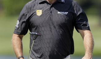 Defending champion Lee Westwood, of England, smiles as he walks up to the 12th green during the Pro-Am for the St. Jude Classic golf tournament on Wednesday, June 8, 2011, in Memphis, Tenn. (AP Photo/Jeff Roberson)