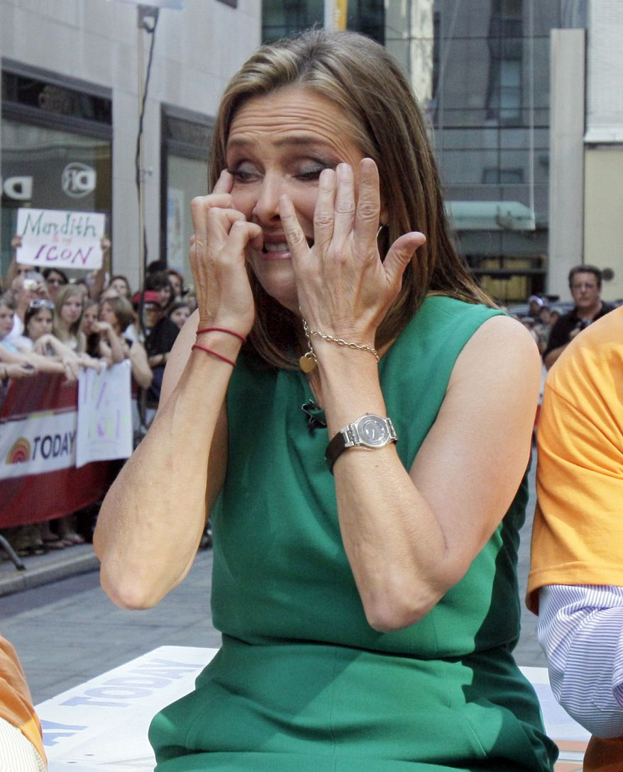 "Meredith Vieira, co-host of the NBC ""Today"" television program, sheds a tear during her final show on June 8, 2011, in New York. (Associated Press)"