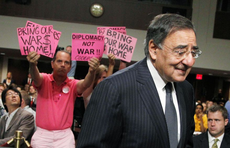 CodePink members greet CIA Director Leon Panetta as he arrives Thursday on Capitol Hill for a hearing on his nomination to be the next secretary of defense. (Associated Press)