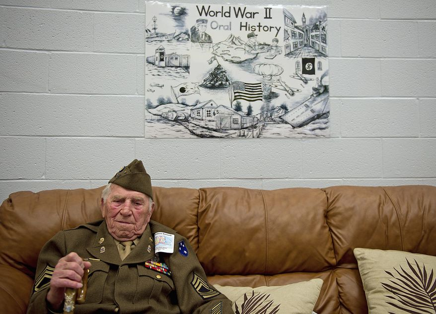 William Hanusek (above), of Alexandria, served in the U.S. Army at Guadalcanal in the Pacific during World War II. He was among the veterans and civilians who talked about their wartime experience with students Thursday at Rocky Run Middle School in Chantilly. (Barbara L. Salisbury/The Washington Times)