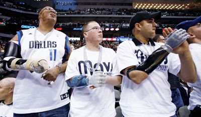 Army Sgt. 1st Class Leroy A. Petry, here at a December 2009 NBA basketball game in Dallas, is scheduled to receive the Medal of Honor on July 12 from the president. (Associated Press)