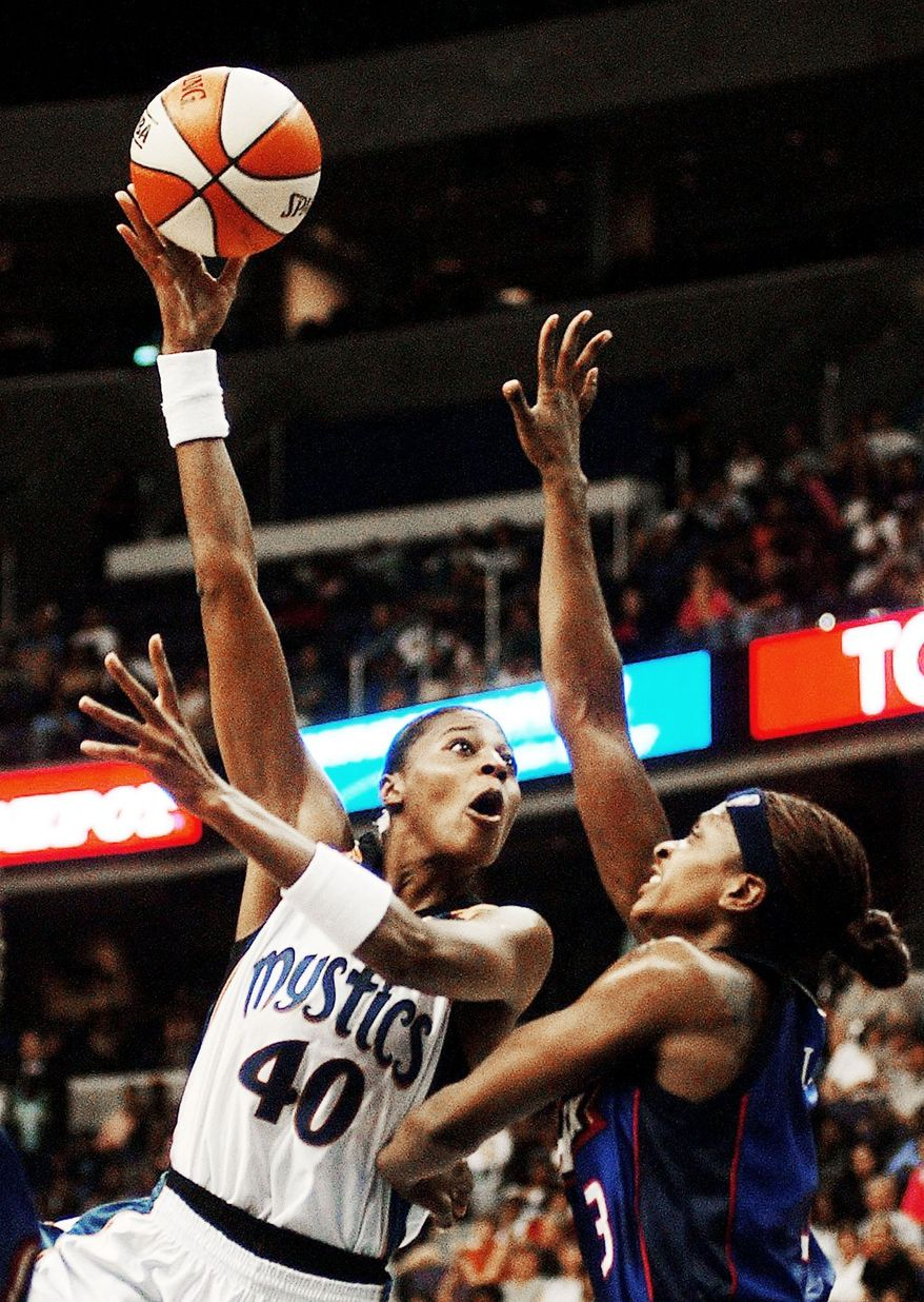 Washington Mystics forward Vicky Bullett (40) goes up for a hook-shot against Shock F Wendy Palmer (3) in first-half action against the Detroit Shock at MCI Center in Washington, DC on Tuesday June 18, 2002. Bullett will be inducted into the Women's Basketball Hall of Fame on Saturday, becoming the third Terrapin to achieve the milestone. ( Ross D. Franklin / The Washington Times )
