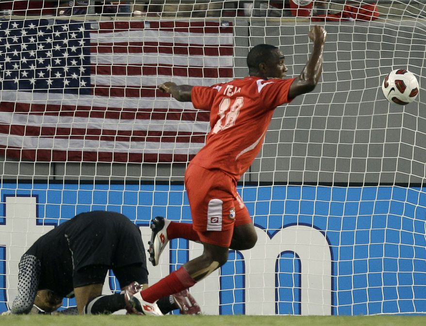 Panama's Luis Tejada (18) celebrates after scoring against United States goalkeeper Tim Howard, left, during the first half of a CONCACAF Gold Cup soccer matchon Saturday, June 11, 2011, in Tampa, Fla. United States lost 2-1. (AP Photo/Chris O'Meara)