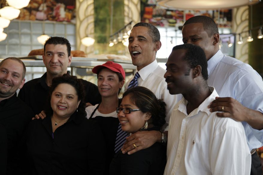 ** FILE ** President Barack Obama, center, and Rep. Kendrick Meek, D-Fla., second from right, pose for photos at Jerry's Famous Deli after a fundraiser for Florida Democrats, in this Aug. 18, 2010, file photo taken in Miami Beach, Fla. President Barack Obama has problems in Florida that he didn't have when he won the pivotal swing state in 2008. (AP Photo/Carolyn Kaster, FILE)