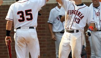 NCAA baseball Super Regional: Virginia's Jared King (13) celebrates a three-run homer with teammate Kenny Swab (35) against UC Irvine during Game 1 of the NCAA college baseball tournament Super Regional on Saturday June 11, 2011, in Charlottesville, Va. Virginia won 6-0. (AP Photo/Andrew Shurtleff)