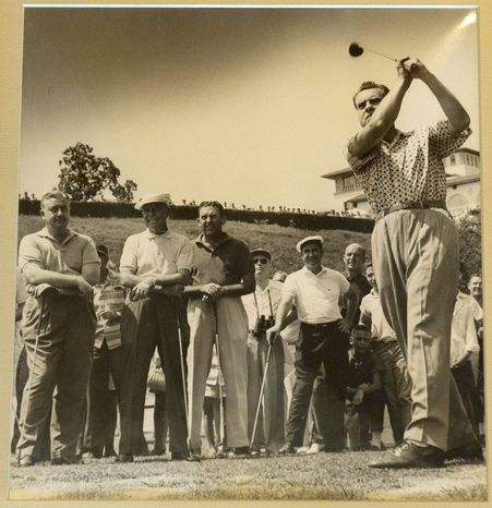 Vice President Richard M. Nixon drives from the tee at Congressional in August 1957 in one of the photos on display in the club's History Hall. (Congressional Country Club)