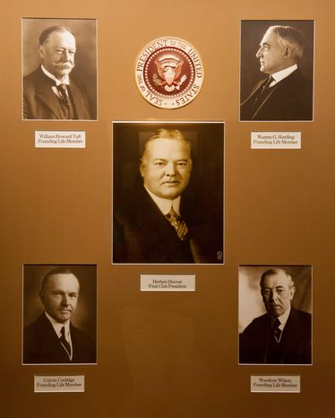 The portraits of five U.S. presidents who were life members, including Herbert Hoover, who was the first club president, are on display in Congressional Country Club's History Hall in Bethesda. (Congressional Country Club Photograph)